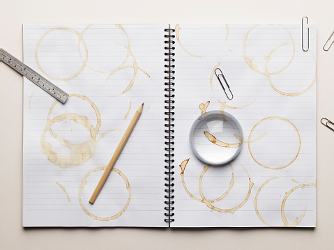 Coffee Break「Notebook with empty coffee cup and lots of coffee stains」:スマホ壁紙(10)