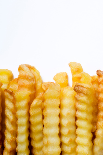 Deep Fried「Crinkle Cut Oven Chips or French Fries White Background」:スマホ壁紙(11)