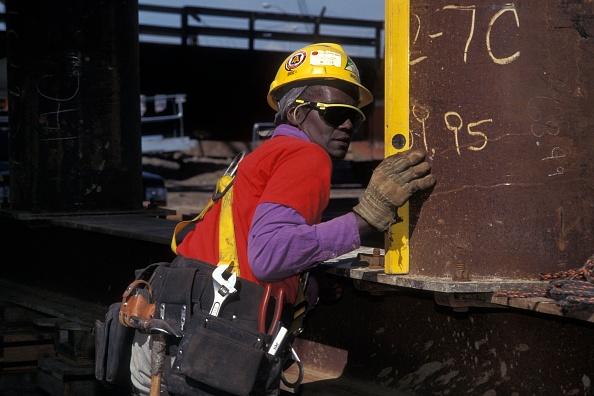 Construction Site「Female construction worker using level on bridge falsework」:写真・画像(8)[壁紙.com]