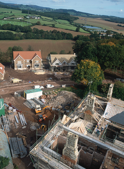 Brick Wall「Cardiff, Cefn Mably. Luxury housing development in 12 acres of parkland by regional developer Meadgate Homes overlooking countryside. Conversion of 16th century Grade II listed country house in foreground.  View from the site tower crane showing chimneys」:写真・画像(10)[壁紙.com]