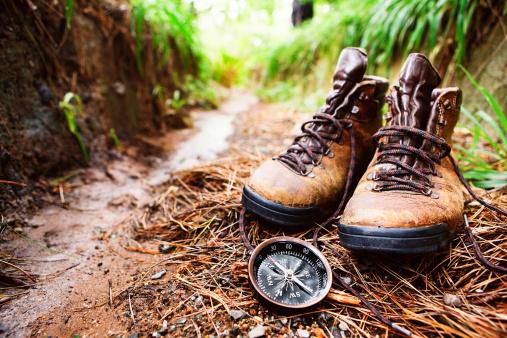 Hiking「Worn hiking boots and compass on muddy walking trail」:スマホ壁紙(16)