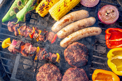 Barbecue Grill「A Beautiful Mixed Grill Meat And Fresh Vegetables Arranged On A Charcoal Grill」:スマホ壁紙(13)