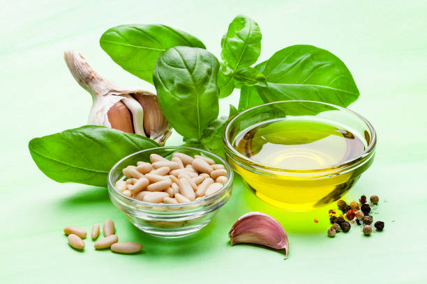 Pesto sauce ingredients on green background:スマホ壁紙(壁紙.com)