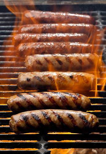 Hot Dog「Bratwurst or Hot Dogs on Grill with Flames」:スマホ壁紙(0)