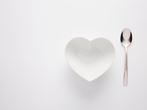 Heart「Heart Shaped Bowl with a spoon next to it on a White background」:スマホ壁紙(1)