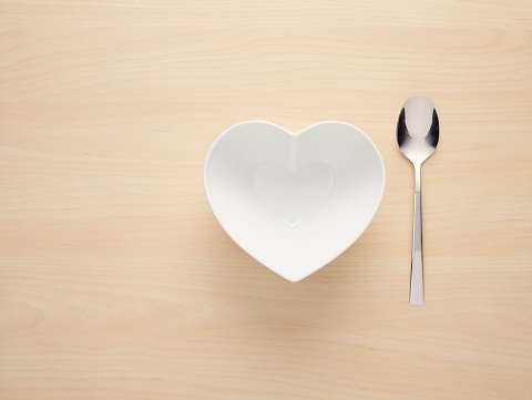 Heart「Heart Shaped Bowl with a spoon next to it on a Wooden background」:スマホ壁紙(9)