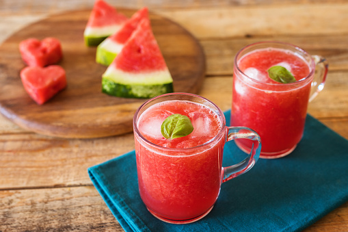 Juice - Drink「Heart shaped watermelon pieces on wood plate with watermelon juice」:スマホ壁紙(5)