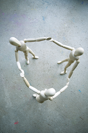 Equality「Three wooden manikins holding hands on grey ground」:スマホ壁紙(4)