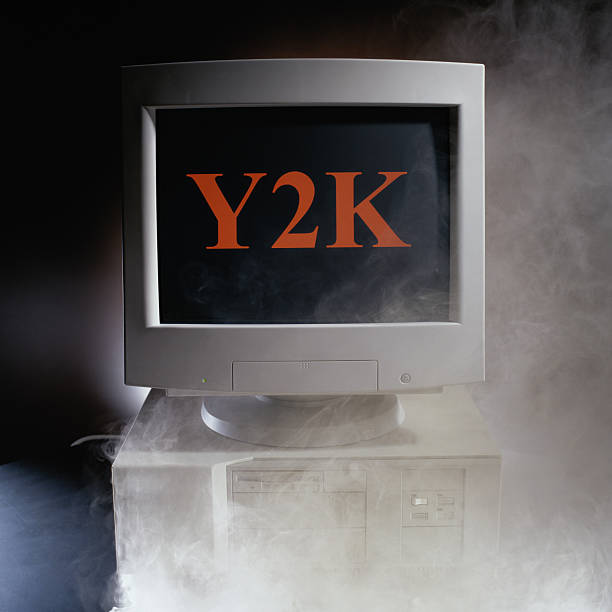 Smoking Computer Showing Y2K:スマホ壁紙(壁紙.com)