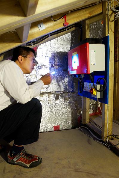 Mid Adult Men「Man looking at solar electricity unit」:写真・画像(14)[壁紙.com]
