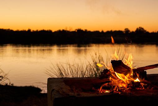Caprivi Strip「Bonfire at riverbank during sunset at Caprivi Strip, Namibia」:スマホ壁紙(9)