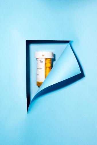 Respect「Blue paper  revealing prescrition bottle with pill」:スマホ壁紙(4)
