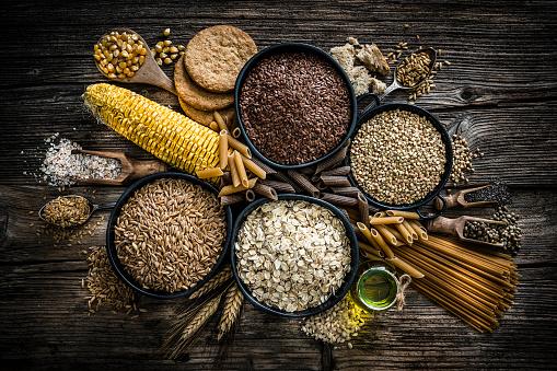 Brown Rice「Dietary fiber: large group of wholegrain food shot on rustic wooden table」:スマホ壁紙(8)
