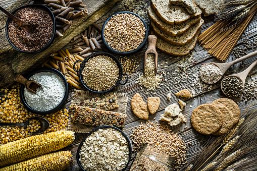 Buckwheat「Dietary fiber: large group of wholegrain food shot on rustic wooden table」:スマホ壁紙(13)