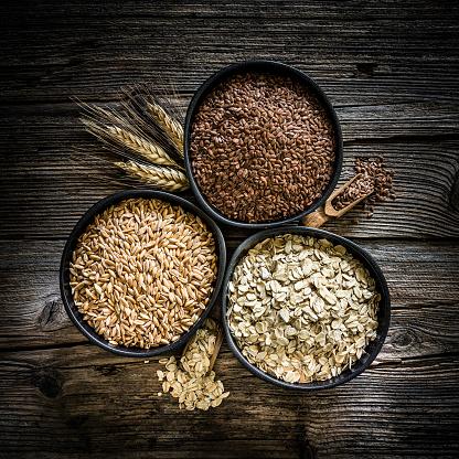 Macrobiotic Diet「Dietary fiber: spelt, oat flakes and flax seeds shot on rustic wooden table」:スマホ壁紙(17)