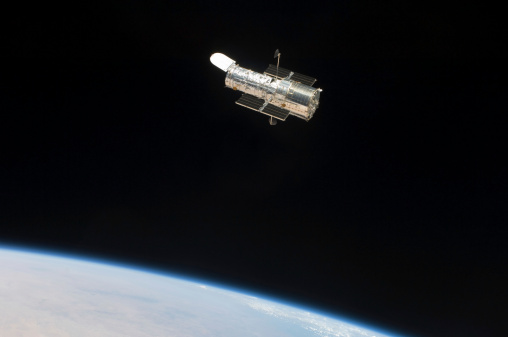 Hubble Space Telescope「The Hubble Space Telescope in orbit above Earth.」:スマホ壁紙(11)