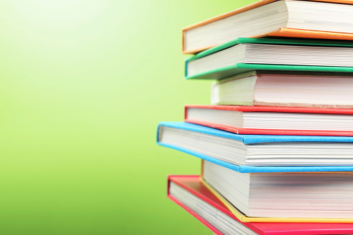 Green Background「Stack of Colorful Books」:スマホ壁紙(7)