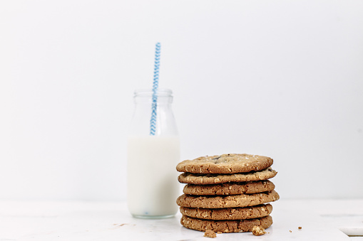 Side View「Stack of cookies and bottle of milk with a straw」:スマホ壁紙(16)