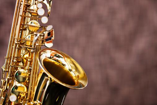 Rock Music「Golden saxophone shines against a dark out-of-focus background」:スマホ壁紙(15)
