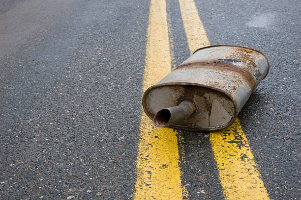 Old rusted muffler laying in the center of the road:スマホ壁紙(壁紙.com)