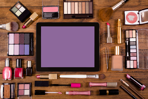 Vanity「Various cosmetics surround a digital tablet on dressing table.」:スマホ壁紙(15)