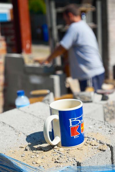 Crockery「Mug with bricklayer in background」:写真・画像(1)[壁紙.com]