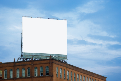 Marketing「USA, Maryland, Baltimore, Billboard on Copycat building, low angle view」:スマホ壁紙(5)