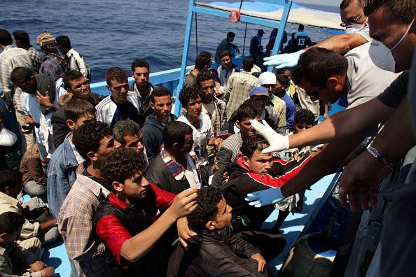 Refugee「Italian Border Patrols Pick Up Boatloads Of Illegal Immigrants」:写真・画像(14)[壁紙.com]