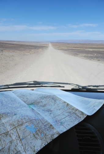 Dirt Road「Map on dashboard of car on remote road」:スマホ壁紙(4)