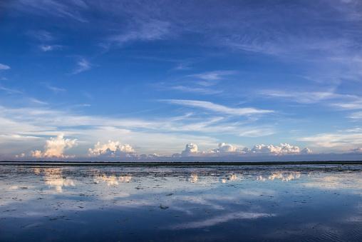 静かな情景「Bangladesh, Sunamgonj, Cumulus clouds reflecting in water」:スマホ壁紙(12)