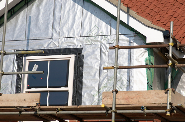 Insulation「Construction of a detached house showing the insulation layer, Ipswich, UK」:写真・画像(5)[壁紙.com]