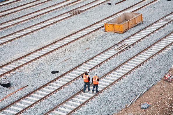 Railroad Track「Construction workers walk along newly laid tracks at the New Cross Gate Depot in South London, which will serve the extended London Overground East London Line.」:写真・画像(19)[壁紙.com]
