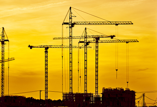Russia「Construction site at dusk evening yellow light, crane」:スマホ壁紙(13)