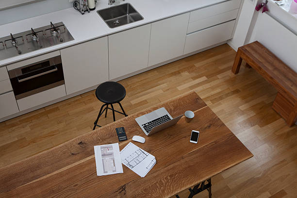 Construction plan, laptop, calculator and cell phone on kitchen table:スマホ壁紙(壁紙.com)