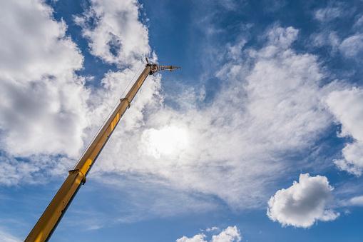 Pole「Construction crane, blue skies with clouds.」:スマホ壁紙(10)
