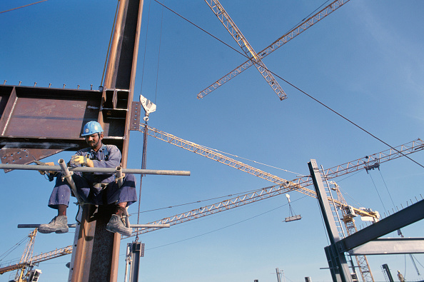 Indian Subcontinent Ethnicity「Construction worker during steel frame work on the Gateway building for the new financial zone - with tower cranes criss crossing overhead, Dubai Finance District, UAE.」:写真・画像(12)[壁紙.com]