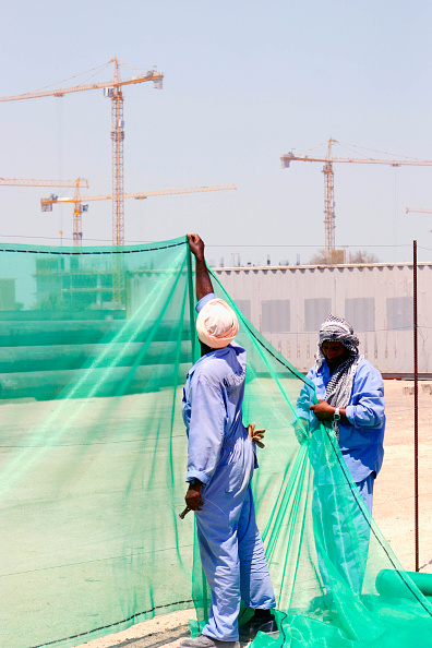 Mid Adult「Construction Workers putting up a fence」:写真・画像(5)[壁紙.com]