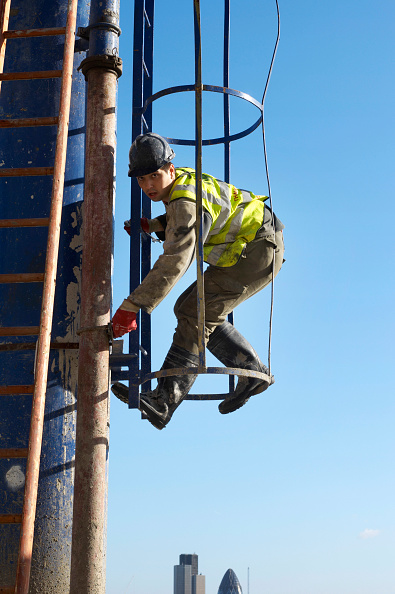 Risk「Construction worker working in caged ladder, accessing a concrete pump, New St Square」:写真・画像(16)[壁紙.com]