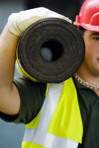 Caucasian Ethnicity「Construction worker holding Felt asphalt material on his shoulder」:写真・画像(11)[壁紙.com]