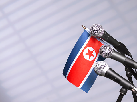 Party Conference「North Korean flag and mics」:スマホ壁紙(6)