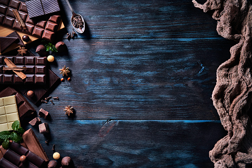 chestnut「Low key image of a variety of chocolate and bombones with dried fruit. Old fashioned style on a blue rustic table with copy space」:スマホ壁紙(16)