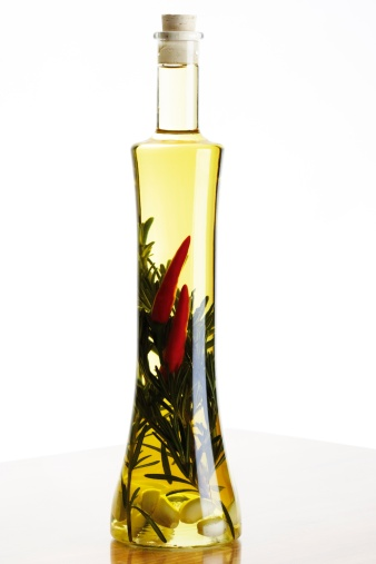 Seasoning「Bottle of olive oil with herbs and spices, close-up」:スマホ壁紙(4)