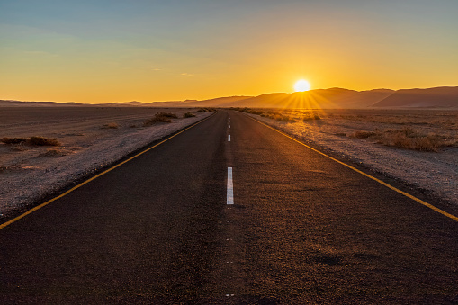 Atmosphere「Africa, Namibia, Namib desert, Naukluft National Park, empty road at sunset」:スマホ壁紙(0)