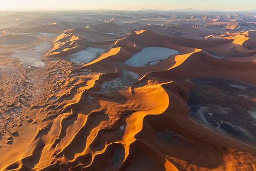 UNESCO World Heritage Site「Africa, Namibia, Namib desert, Namib-Naukluft National Park, Aerial view of desert dunes, Dead Vlei and 'Big Daddy' in the morning light」:スマホ壁紙(1)