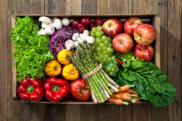 Crate full of fruits and vegetables over rustic table:スマホ壁紙(壁紙.com)