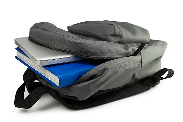 A grey backpack open to show a tablet and blue book:スマホ壁紙(壁紙.com)