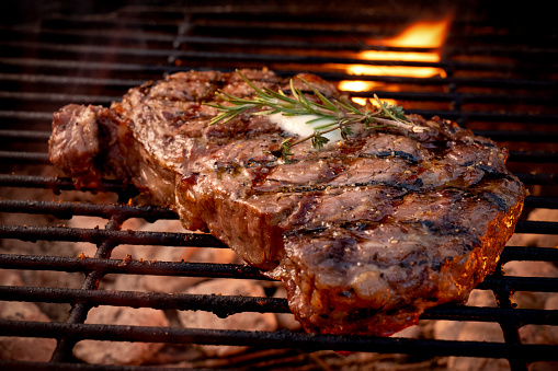 Barbecue Grill「Large Juicy Beef Rib Eye Steak on a Hot Grill with Charcoal and Flames」:スマホ壁紙(5)