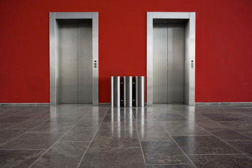 Waiting「Red wall, two elevator doors, copy space」:スマホ壁紙(7)