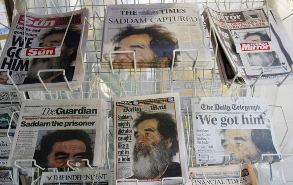 Trapped「Papers Run Story On Saddam Capture」:写真・画像(13)[壁紙.com]