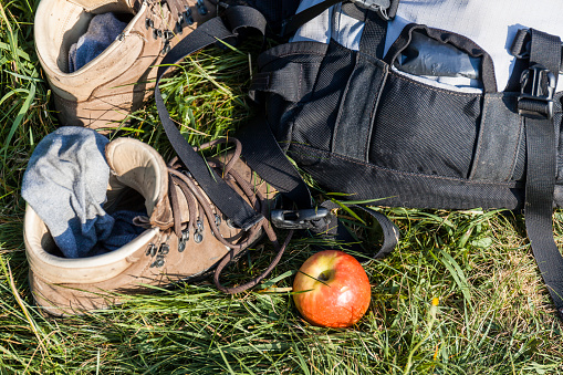 Hiking「Hiking boots, backpack and apple on a meadow」:スマホ壁紙(0)